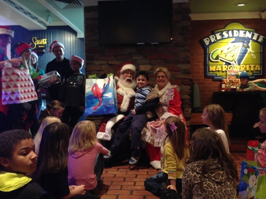 Springfield area children participating in the Big Brothers Big Sisters program visit with Santa last December at Chili's Restaurant. City wide, there are about 308 kids in the Big Brothers and Big Sisters program, according to program employee Chelsea Foresee.