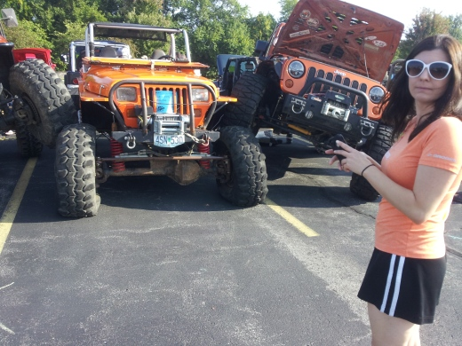 Middle College science teacher Stephanie Blake takes a moment to admire some of the unique vehicles on display at the ANPAC Car Show in September.  Blake contemplated owning her own modified Jeep Wrangler one day after attending the show.