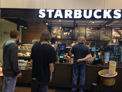 MC students Ryan Crutcher and Josh Goin wait in line to order at the new Starbucks. Both students do not make a habit of buying Starbucks but use it as treat for themselves once in a while.