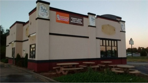"A ""coming soon"" sign hangs on the outside of the former Backyard Burgers location in South Springfield. According to Google, there were 7,677 Dunkin' Donuts retail locations around the country as of December 2013."