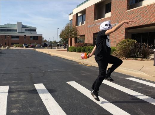 Darren Myers, Middle College counselor, dresses up as Jack Skellington skips across the crosswalk at ITTC building at OTC - Springfield. Pedestrian accidents are among the most common dangers children face each Halloween night.