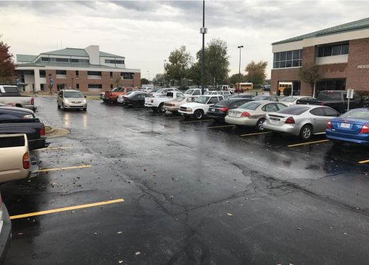 An OTC student drives slowly through the ITTC parking lot due to the rain Oct. 26.